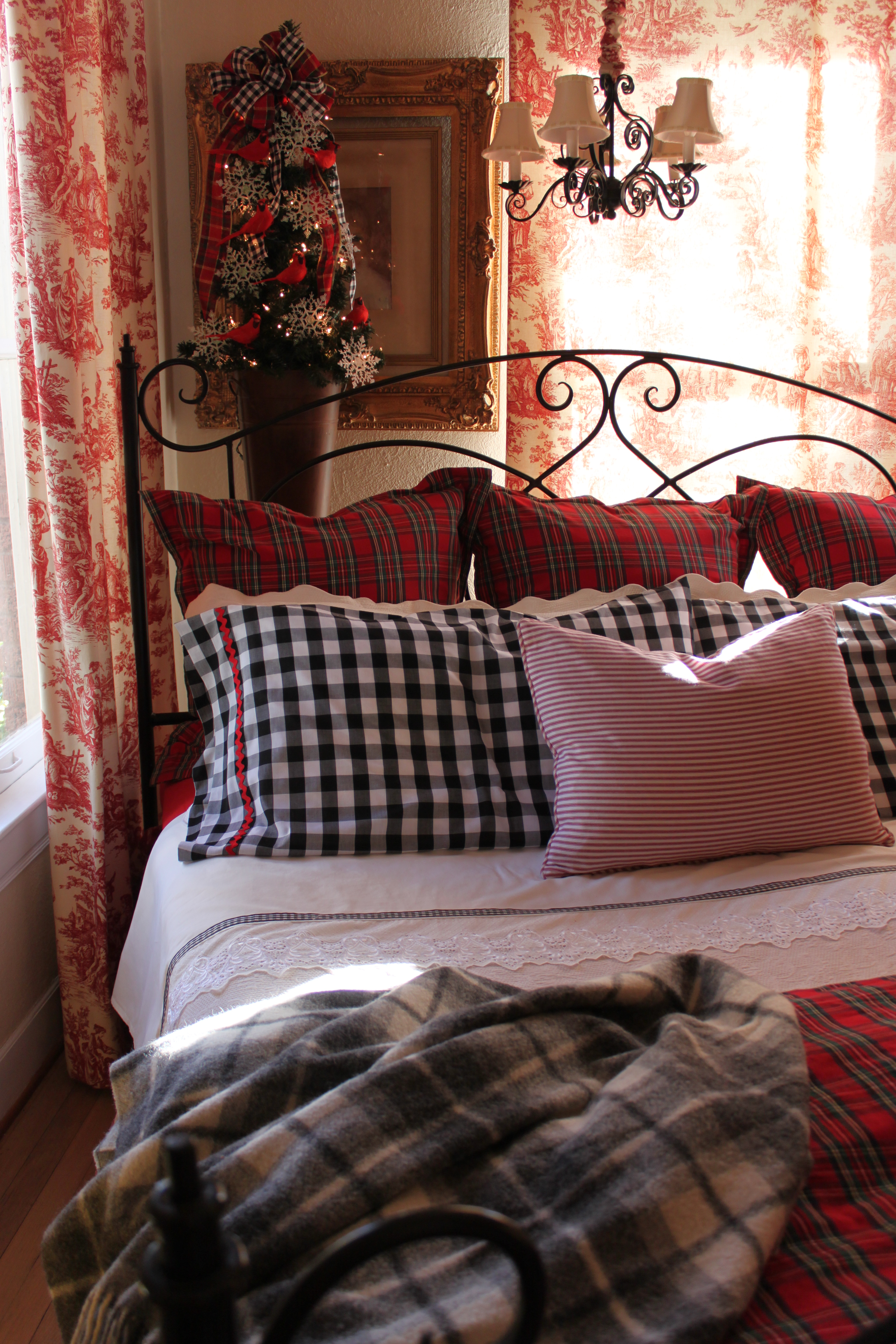 but somewhere a few years back the plaid bedding went to the attic and never came back down i mean seriously if you have so much christmas stuff that you